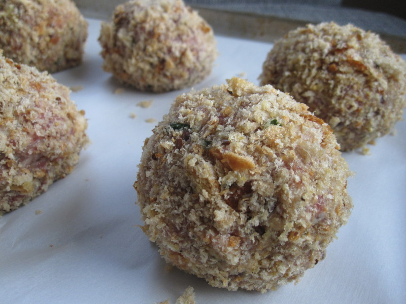 Scotch eggs breaded and ready to bake